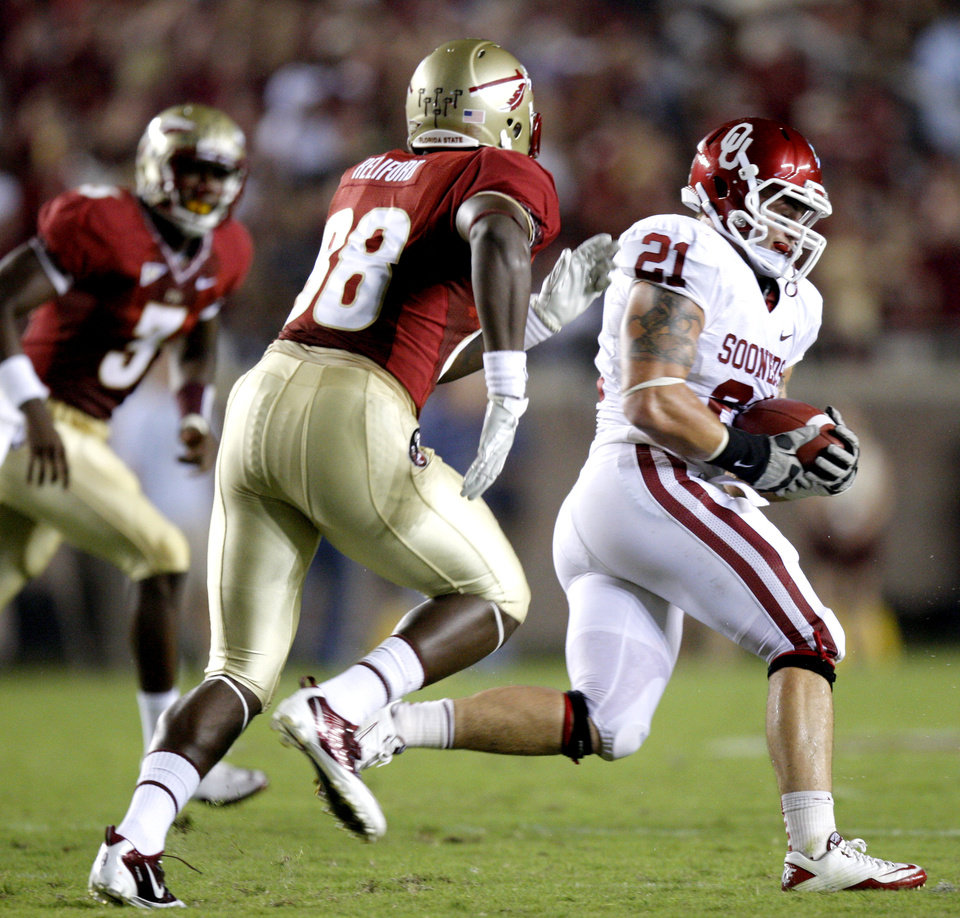 Oklahoma's Tom Wort (21) runs past Florida's Beau Reliford (88) after an interception during a college football game between the University of Oklahoma (OU) and Florida State (FSU) at Doak Campbell Stadium in Tallahassee, Fla., Saturday, Sept. 17, 2011. Photo by Bryan Terry, The Oklahoman