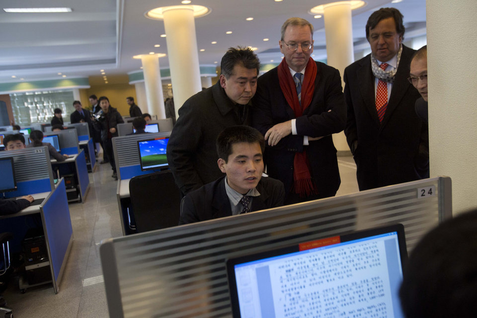 Photo - Executive Chairman of Google, Eric Schmidt, third from left, and former New Mexico governor Bill Richardson, second from right, watch as a North Korean student surfs the Internet at a computer lab during a tour of Kim Il Sung University in Pyongyang, North Korea on Tuesday, Jan. 8, 2013. Schmidt is the highest-profile U.S. executive to visit North Korea - a country with notoriously restrictive online policies - since young leader Kim Jong Un took power a year ago. (AP Photo/David Guttenfelder)