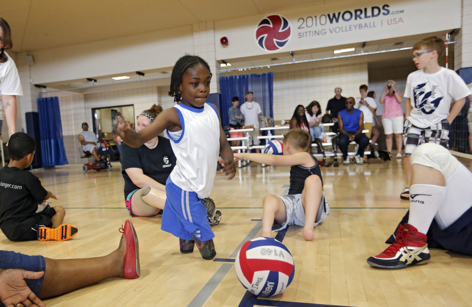 Harvey Parry, 7, of the UK, plays in the sitting volleyball clinic during the opening day of activities for the Endeavor Games at the University of Central Oklahoma on Thursday, June 6, 2013 in Edmond, Okla. Photo by Chris Landsberger, The Oklahoman