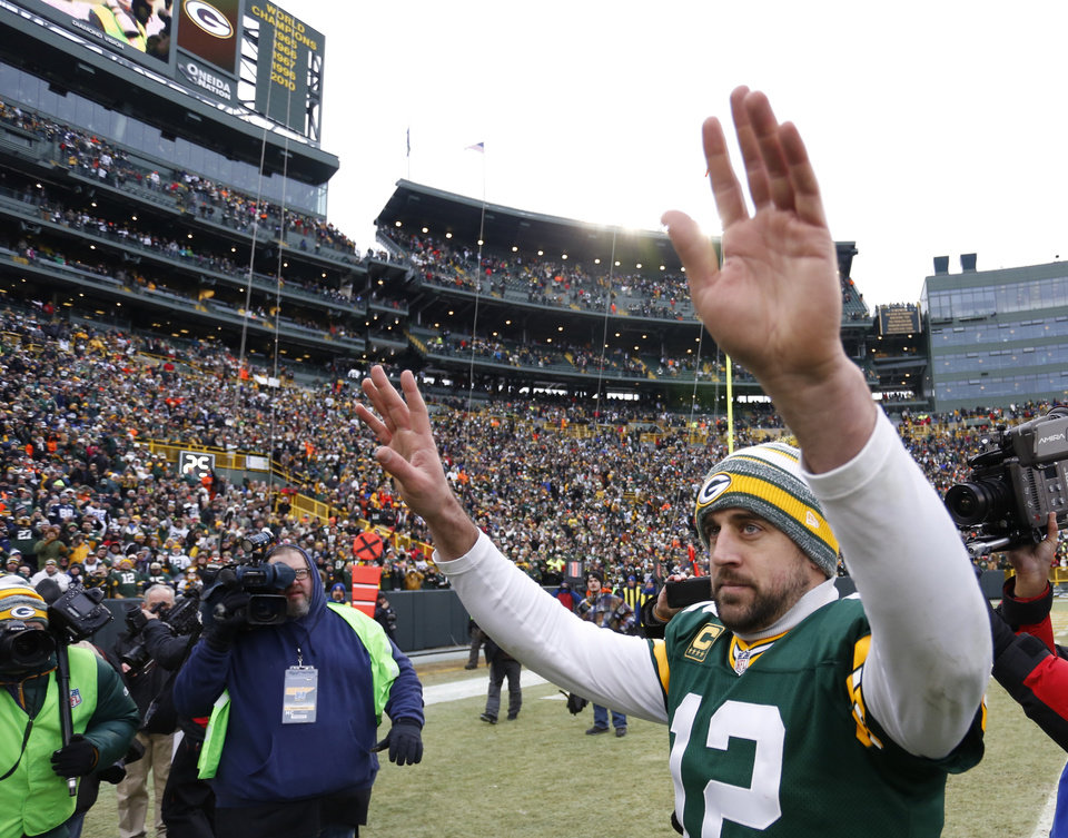 Photo - Green Bay Packers quarterback Aaron Rodgers waves to fans after an NFL divisional playoff football game against the Dallas Cowboys Sunday, Jan. 11, 2015, in Green Bay, Wis. The Packers won 26-21. (AP Photo/Matt Ludtke)