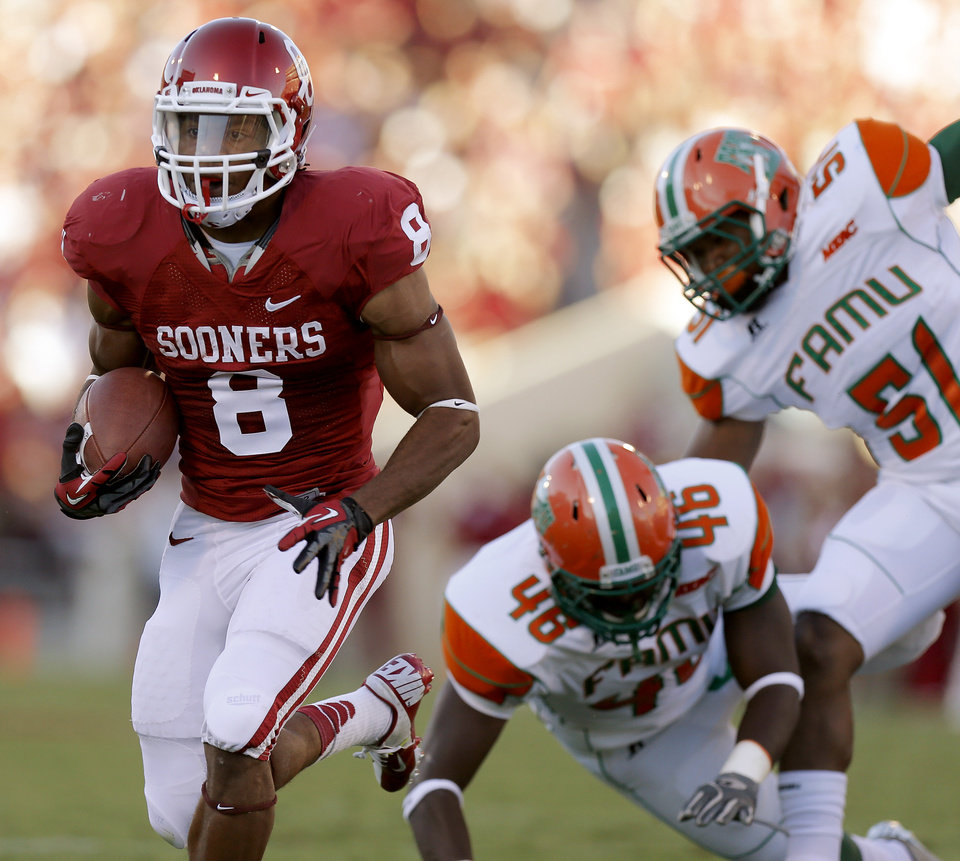 Oklahoma\'s Dominique Whaley (8) runs during the college football game between the University of Oklahoma Sooners (OU) and Florida A&M Rattlers at Gaylord Family—Oklahoma Memorial Stadium in Norman, Okla., Saturday, Sept. 8, 2012. Photo by Bryan Terry, The Oklahoman