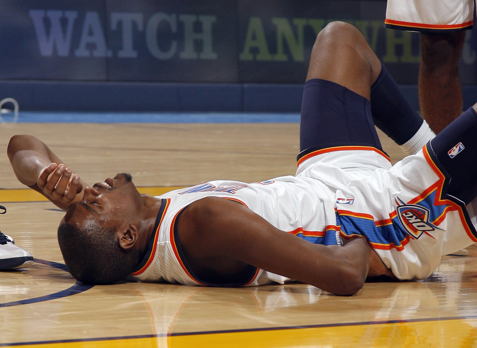 Photo - Oklahoma City's Kevin Durant reacts after hitting the floor during the NBA season opener basketball game between the Oklahoma City Thunder and the Chicago Bulls in the Oklahoma City Arena on Wednesday, Oct. 27, 2010. Photo by Sarah Phipps, The Oklahoman
