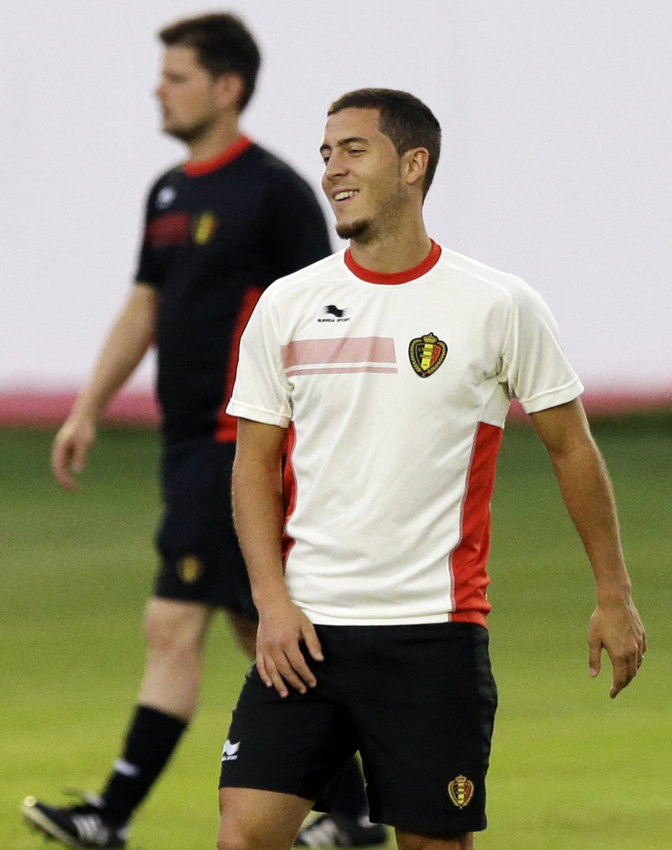 Photo - Belgium's Eden Hazard smiles as he takes part in a training session at Estadio Manoel Barradas, the day before the World Cup round of 16 soccer match between Belgium and USA at Arena Fonte Nova in Salvador, Brazil, Monday, June 30, 2014. (AP Photo/Matt Dunham)