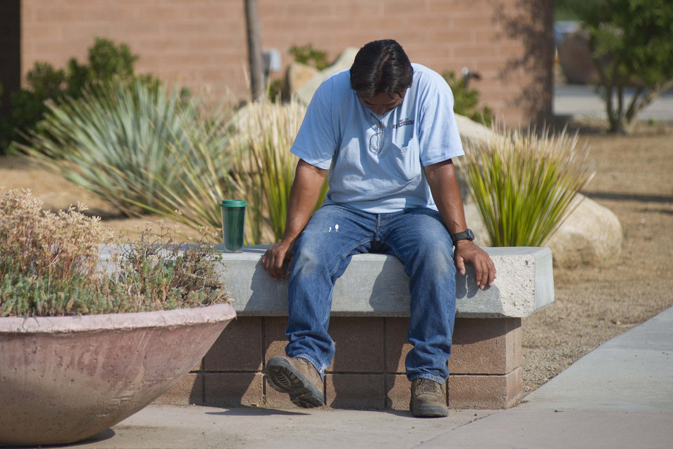 Photo - Thomas Herrera   waits for news about whether or not his home survived the Yarnell Hill Fire on Monday, July 1, 2013, at the Red Cross shelter at Yavapai College in Prescott, Ariz. The wildfire destroyed 200 houses in the town of Yarnell and the nearby community of Glen Isla. Nineteen firefighters from an elite crew from Prescott were killed in the blaze.(AP Photo/The Arizona Republic, Aaron Lavinsky)  MARICOPA COUNTY OUT; MAGS OUT; NO SALES