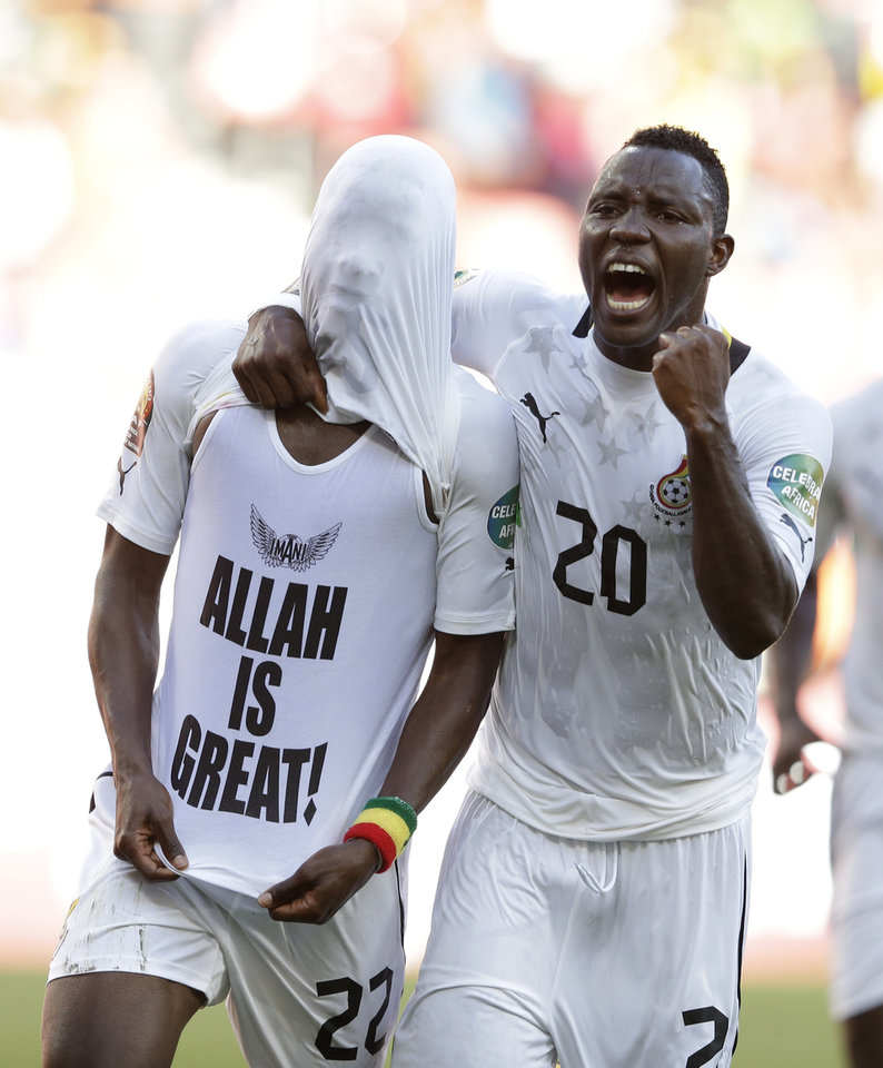 Ghana's Kwadwo Asamoah, right, and Mubarak Wakaso celebrate after Wakaso scored against Mali in their African Cup of Nations Group B soccer match, at Nelson Mandela Bay Stadium in Port Elizabeth, South Africa, Thursday, Jan. 24, 2013. (AP Photo/Rebecca Blackwell)