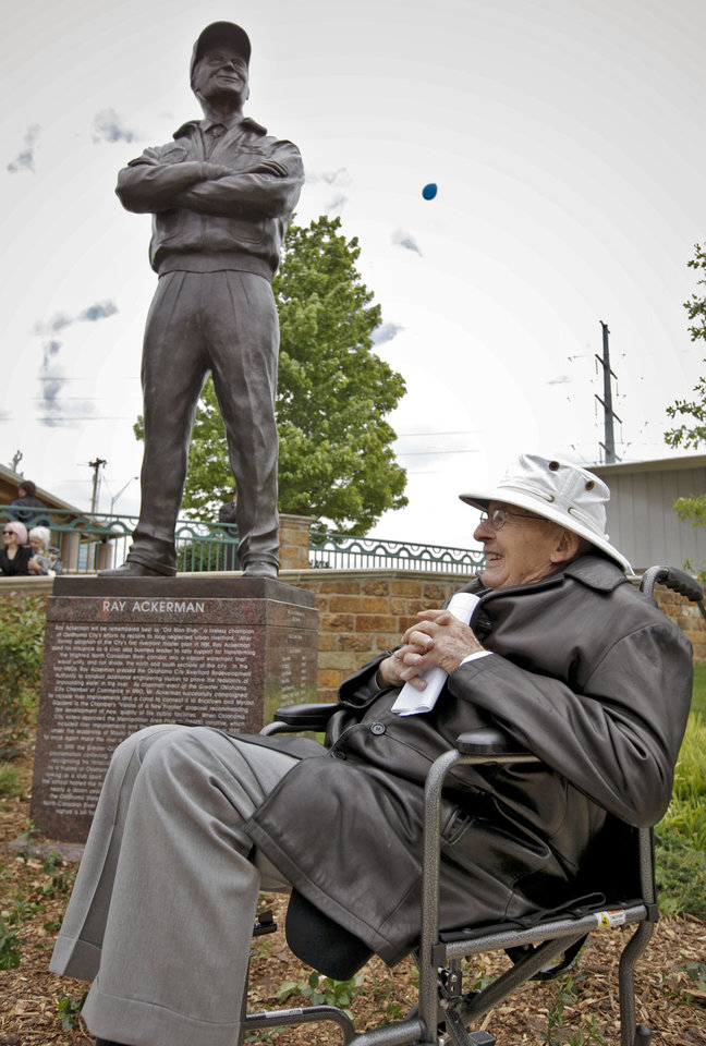 Photo - Ray Ackerman admires the statue put up in his honor for the work he put in on the Oklahoma River during the statue detection of Ray Ackerman near the Chesapeake Boathouse on Friday, April 20, 2012, in Oklahoma City, Oklahoma.  Photo by Chris Landsberger, The Oklahoman