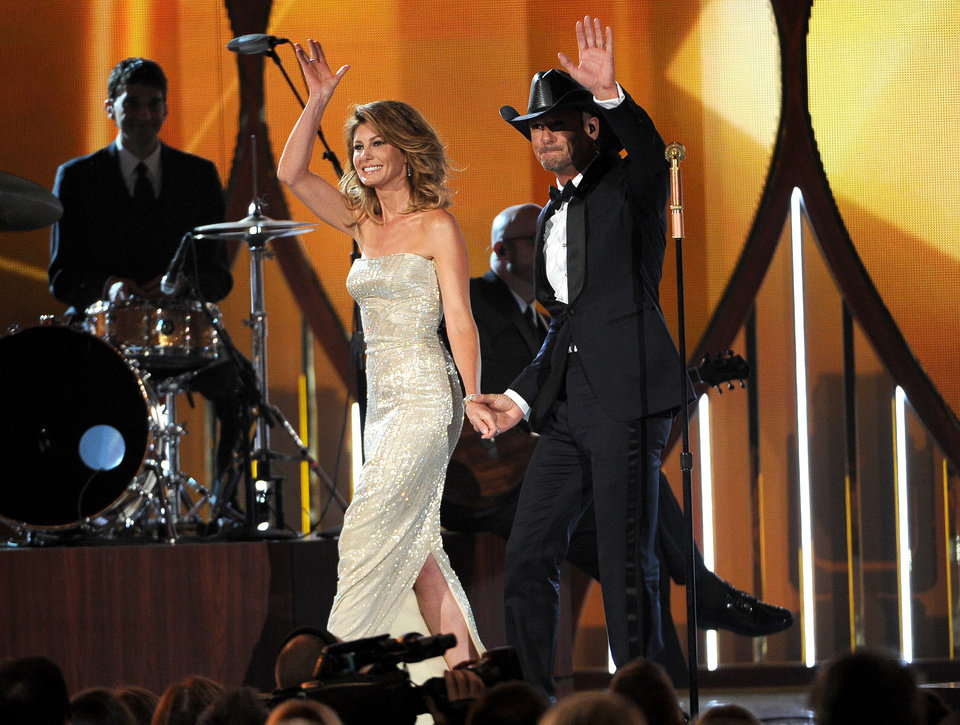 Photo - Faith Hill, left, and Tim McGraw walk on stage at the 49th annual Academy of Country Music Awards at the MGM Grand Garden Arena on Sunday, April 6, 2014, in Las Vegas. (Photo by Chris Pizzello/Invision/AP)