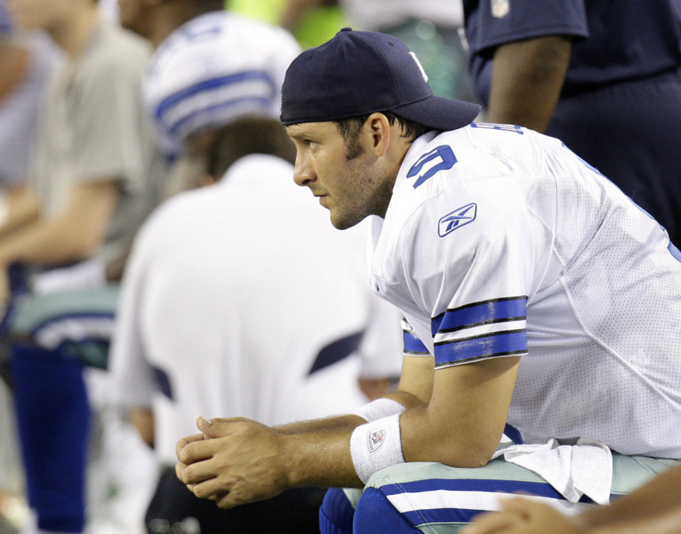 Photo - FILE -- This is a Sept. 20, 2009, file photo showing Dallas Cowboys quarterback Tony Romo (9) during an NFL football game against the New York Giants, in Arlington, Texas. Romo had a chance to show how much he's changed, how he's calmer and more disciplined without Jessica Simpson and Terrell Owens in his life. Instead, in front of an NFL-record crowd of 105,121 and the league's largest prime-time audience in 12 years, Romo gave a convincing performance that he still throws too many passes to guys who don't play for the Dallas Cowboys. (AP Photo/LM Otero, File) ORG XMIT: NY164