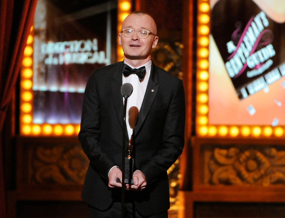 Photo - Darko Tresnjak accepts the award for best direction of a musical for
