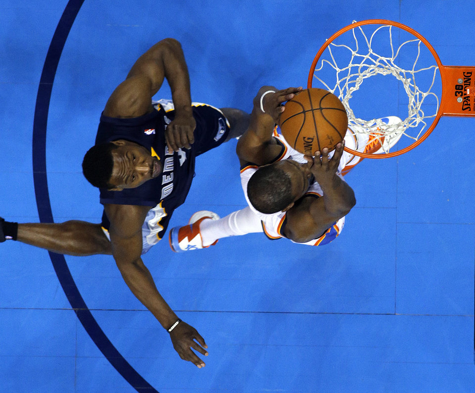 Photo - Kevin Durant (35) dunks as Memphis' Tony Allen (9) defends during Game 1 in the first round of the NBA playoffs between the Oklahoma City Thunder and the Memphis Grizzlies at Chesapeake Energy Arena in Oklahoma City, Saturday, April 19, 2014. Photo by Sarah Phipps, The Oklahoman