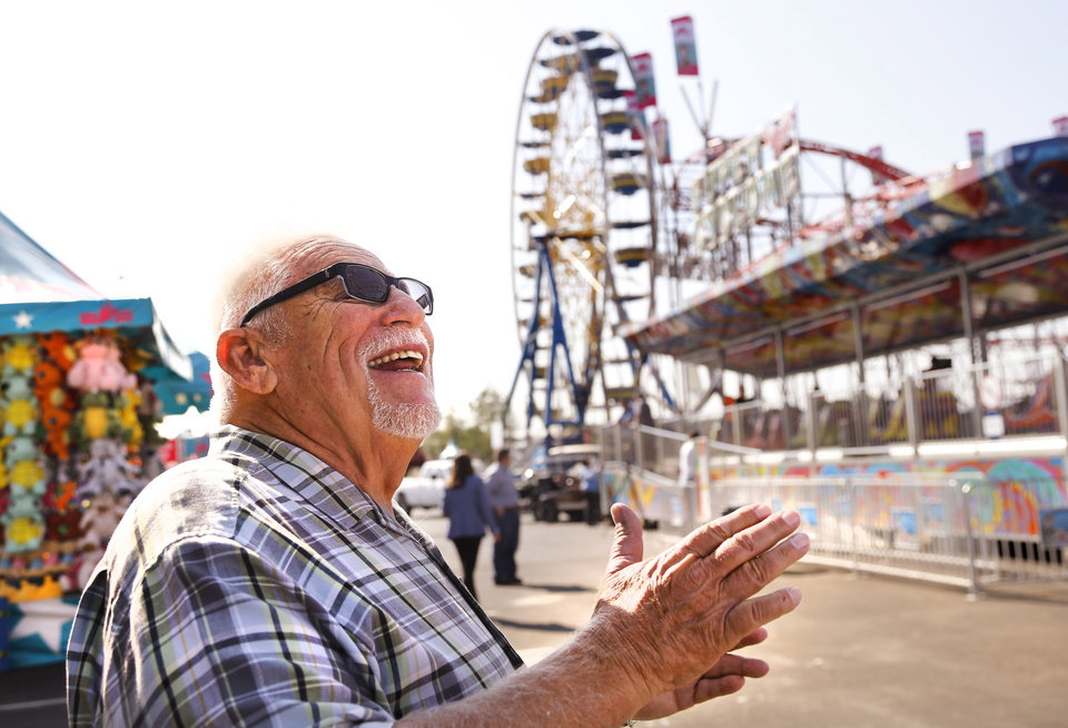 Photo - Frank Zaitshik, 71, laughs Wednesday while recalling his many years in the carnival business. Zaitshik started in 1966 as a teen working in a game booth on the midway. He now owns Wade Shows and brings his carnival to fairs across the nation. Crews spent most of Wednesday, Sep 13, 2017, putting finishing touches on rides and exhibits in advance of the opening of the 2017 Oklahoma State Fair on Thursday.  Photo by Jim Beckel, The Oklahoman
