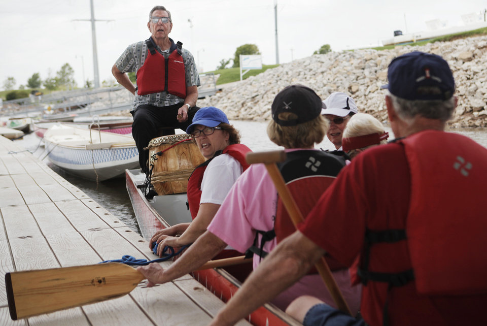 Photo - John Thistelton, 79, sits at the end of a dragon boat waiting to drum for a group of senior citizens from Bethany YMCA on June 19, 2013. Photo by KT KING, The Oklahoman