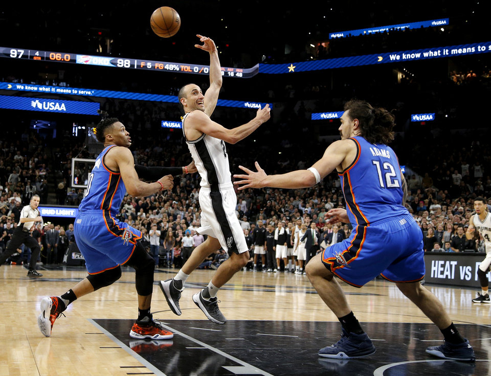 Photo - San Antonio's Manu Ginobili (20) passes the ball from between Oklahoma City's Russell Westbrook (0) and Steven Adams (12) in the final moments of Game 2 of the second-round series between the Oklahoma City Thunder and the San Antonio Spurs in the NBA playoffs at the AT&T Center in San Antonio, Monday, May 2, 2016. Oklahoma City won 98-97. Photo by Bryan Terry, The Oklahoman