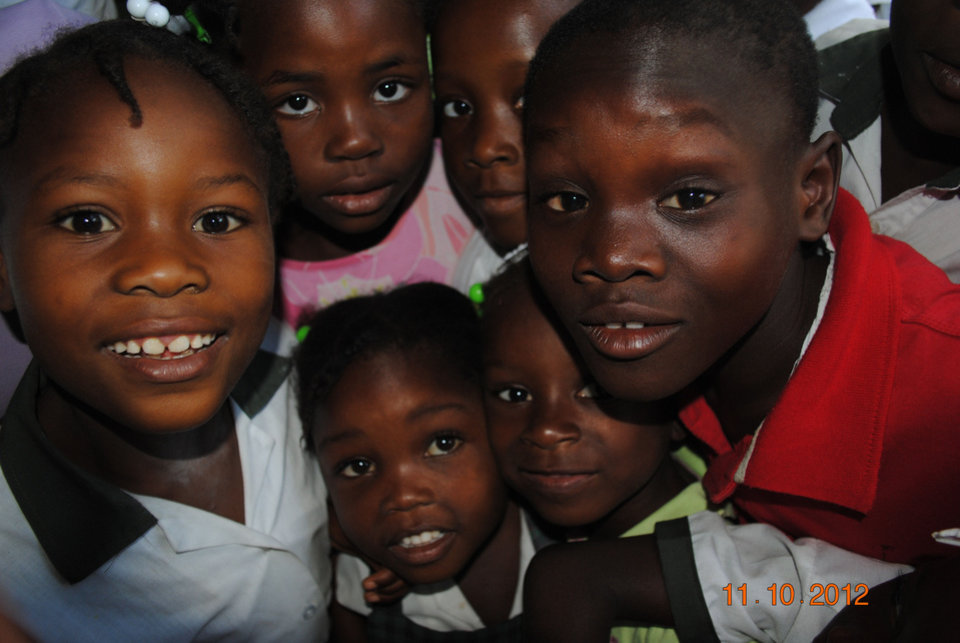Photo - Some of the children of Frettas, Haiti, pose for a photograph in November. Despite living in relatively primitive conditions, the children and their families seem happy and smile often, according to SandRidge Energy workers who volunteer in Frettas.   - Provided