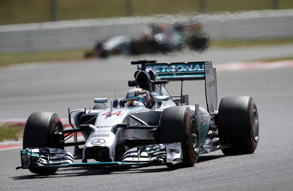 Photo - Britain's Lewis Hamilton of Mercedes rounds the track during a practice session before the British Formula One Grand Prix at Silverstone circuit, Silverstone, England, Friday, July 4, 2014. The British Formula One Grand Prix will be held on Sunday, July 6, 2014. (AP Photo/Lefteris Pitarakis)