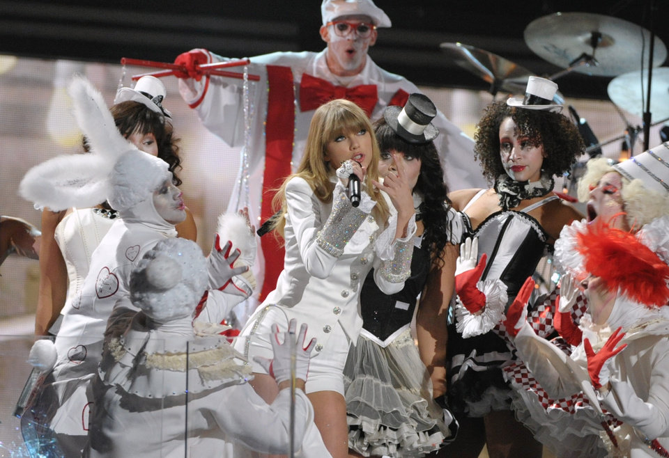 Photo - Taylor Swift performs on stage at the 55th annual Grammy Awards on Sunday, Feb. 10, 2013, in Los Angeles. (Photo by John Shearer/Invision/AP)