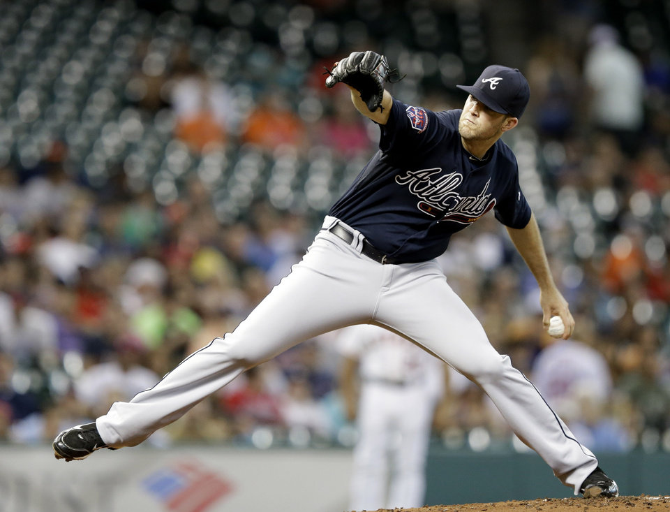 Photo - Atlanta Braves' Alex Wood delivers a pitch against the Houston Astros in the first inning of a baseball game, Wednesday, June 25, 2014, in Houston. (AP Photo/Pat Sullivan)