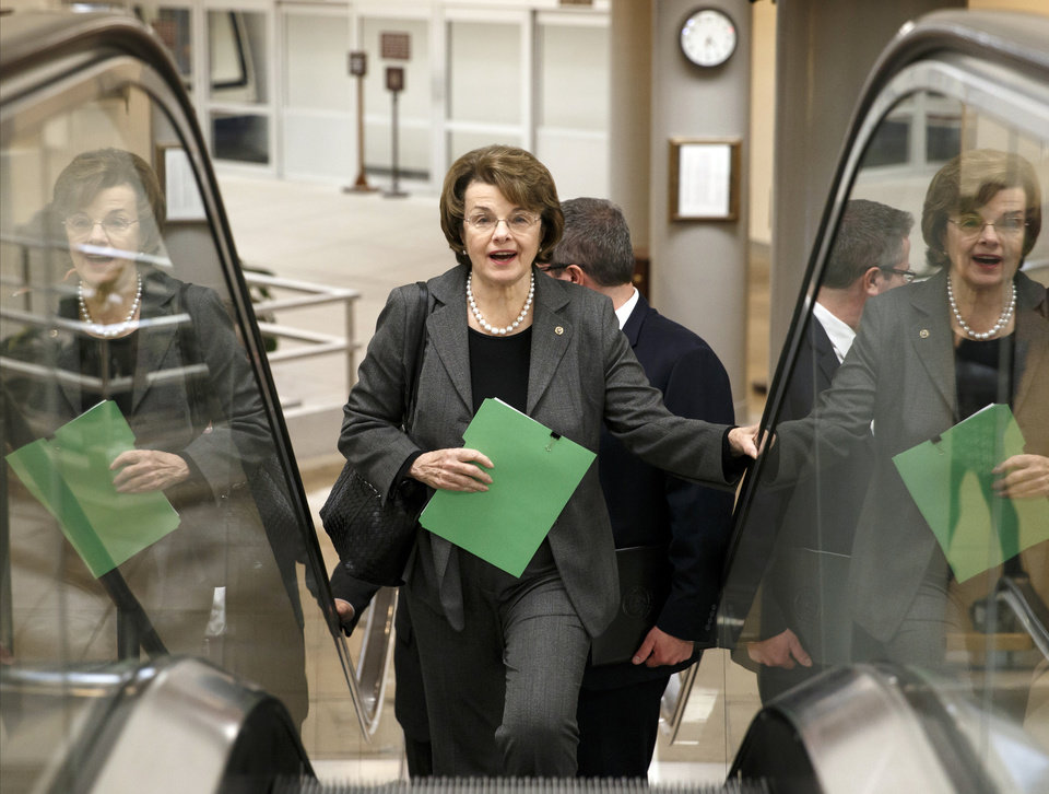 Photo - Sen. Dianne Feinstein, D-Calif., chair of the Senate Intelligence Committee, heads to the chamber to advance a bill providing $1 billion in loan guarantees to Ukraine as President Barack Obama meets with U.S. allies in Europe to punish Moscow for its annexation of the Crimean peninsula, at the Capitol in Washington, Monday, March 24, 2014.  (AP Photo/J. Scott Applewhite)