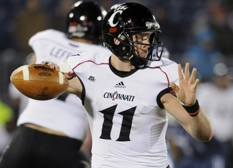 Cincinnati quarterback Brendon Kay (11) throws during the second half of an NCAA college football game against Connecticut at Rentschler Field in East Hartford, Conn., Saturday, Dec. 1, 2012. Cincinnati defeated Connecticut 34-17. (AP Photo/Jessica Hill)