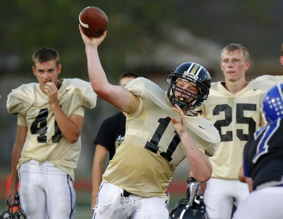 Photo - McAlester's Dalton Wood throws a pass   during a high school football scrimmage in Norman, Okla., Friday, August 26, 2011. Photo by Bryan Terry, The Oklahoman ORG XMIT: KOD