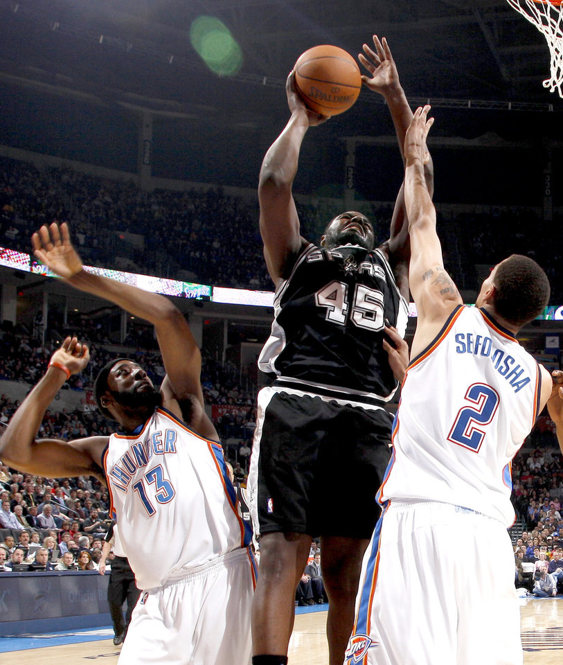 San Anotnio's DeJuan Blair goes to the basket between Oklahoma City's James Harden, left, and Thabo Sefolosha during the NBA basketball game between the Oklahoma City Thunder and the San Antonio Spurs at the Ford Center in Oklahoma City, Wednesday, January 13, 2010. Photo by Bryan Terry, The Oklahoman