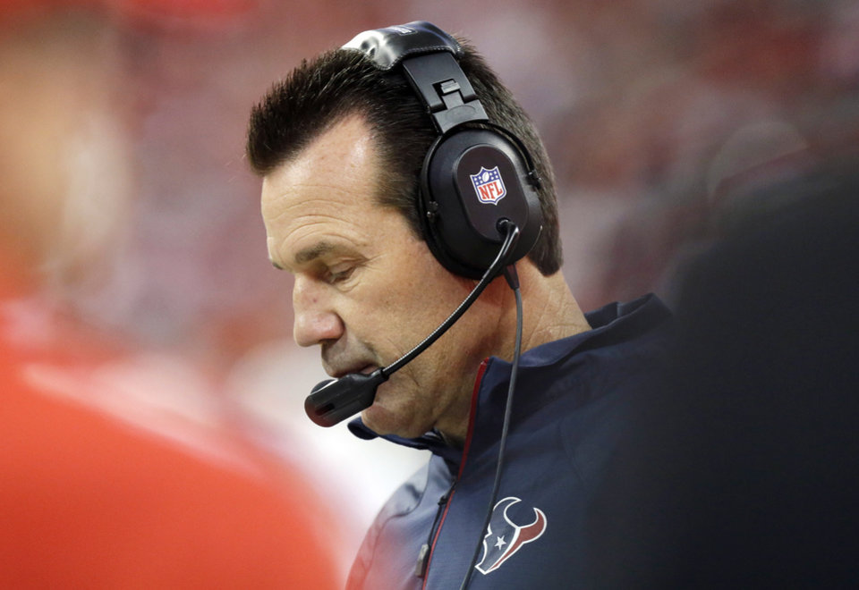 Photo - Houston Texans head coach Gary Kubiak watches from the sidelines during the first quarter of an NFL football game against the Indianapolis Colts, Sunday, Nov. 3, 2013, in Houston. (AP Photo/Patric Schneider)