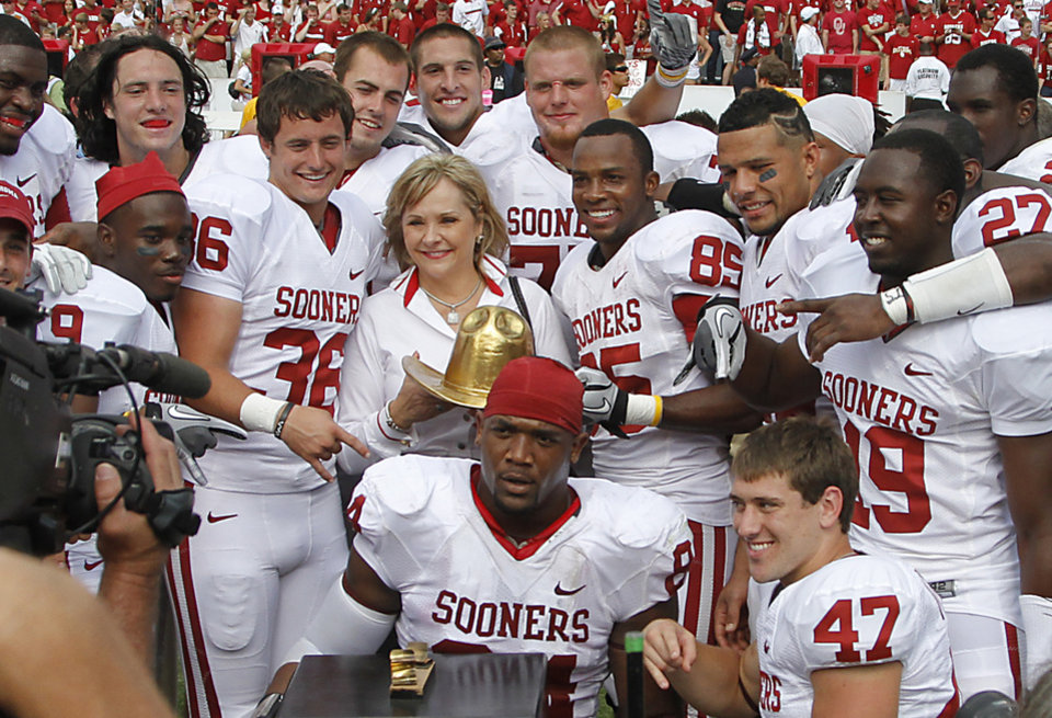 Oklahoma Gov. Mary Fallin holds the Golden Hat trophy as she poses for a photo with members of the Sooners after Oklahoma's 55-17 win over Texas during the Red River Rivalry college football game between the University of Oklahoma Sooners (OU) and the University of Texas Longhorns (UT) at the Cotton Bowl in Dallas, Saturday, Oct. 8, 2011. Photo by Chris Landsberger, The Oklahoman