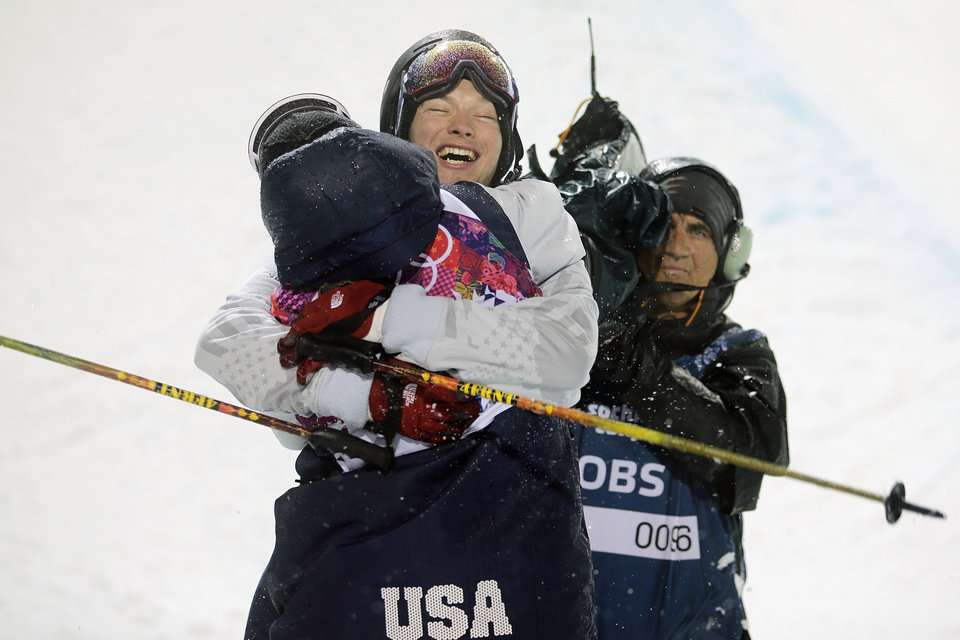 Photo - Gold medalist David Wise, facing camera, of the United States, is congratulated by Aaron Blunck, also of the United States, after the men's ski halfpipe final at the Rosa Khutor Extreme Park, at the 2014 Winter Olympics, Tuesday, Feb. 18, 2014, in Krasnaya Polyana, Russia. (AP Photo/Jae C. Hong)