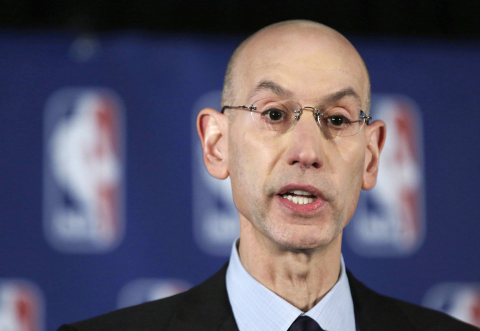 Photo - NBA Commissioner Adam Silver addresses the media during a news conference, in New York, Tuesday, April 29, 2014. Silver announced that he is banning Los Angeles Clipper owner Donald Sterling for life from the Clippers organization over racist comments in a recording. (AP Photo/Richard Drew)