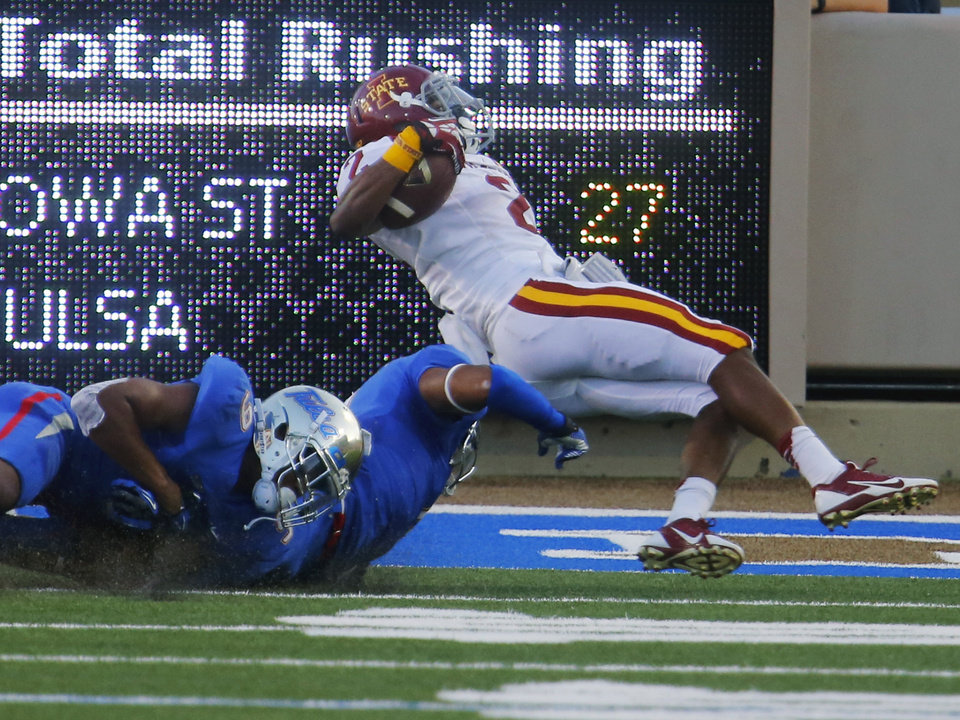Photo - IowIowa State's Aaron Wimberly is taken down by Tulsa's Dwight Dobbins during the first half of an NCAA college football game, Thursday, Sept. 26, 2013 in Tulsa, Okla. (AP Photo/Tulsa World,  Tom Gilbert)  ONLINE OUT; TV OUT; TULSA OUT
