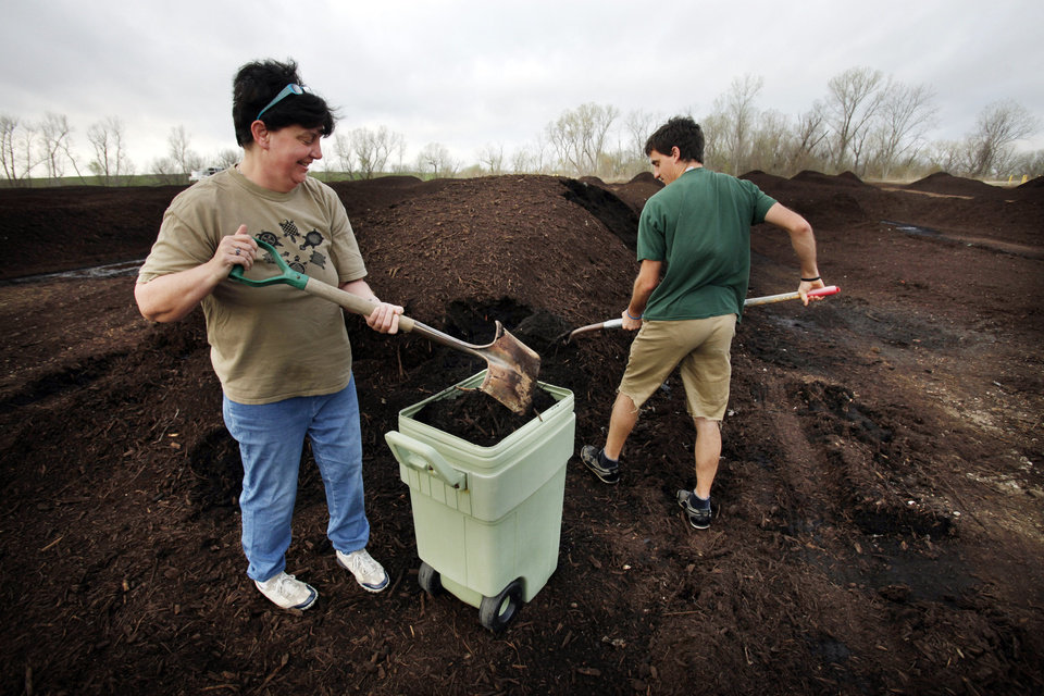 Sonja Pulvino and her son Rory pick up a small load as they join other Norman residents getting compost from the city's composting facility on Saturday, March 17, 2012, in Norman, Okla.   Photo by Steve Sisney, The Oklahoman