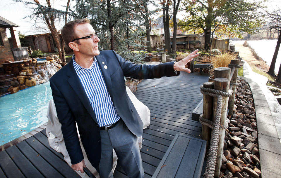 Builder Kurt Dinnes talks about outdoor living features in back of his home in Norman.  Photos by Steve Sisney, THE OKLAHOMAN