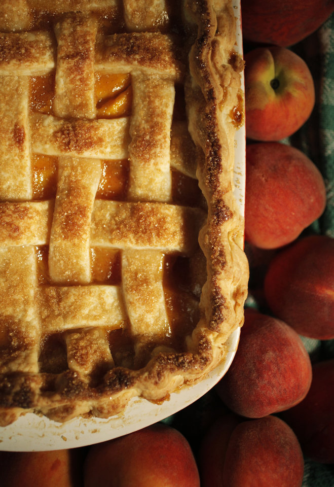 Photo - FOOD: A peach cobbler made from locally grown Oklahoma peaches. Photo by KT KING, The Oklahoman
