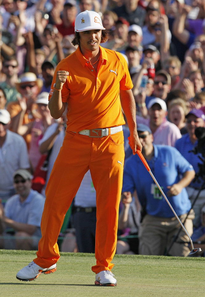 Photo -   Rickie Fowler reacts after making a birdie putt to win the Wells Fargo Championship golf tournament on the first playoff hole at Quail Hollow Club in Charlotte, N.C., Sunday, May 6, 2012. (AP Photo/Gerry Broome)