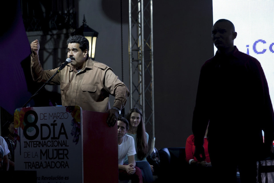 Photo - Venezuela's President Nicolas Maduro speaks at rally in Bolivar Square to commemorate International Women's Day in Caracas, Venezuela, Saturday, March 8, 2014. Maduro's government celebrated an Organization of American States declaration supporting its efforts to bring a solution to the country's worst political violence in years, calling it a diplomatic victory. The United States, Canada and Panama were the only nations to oppose the declaration. Meanwhile street protests continue almost daily while the opposition sits out a peace process it calls farcical. (AP Photo/Alejandro Cegarra)