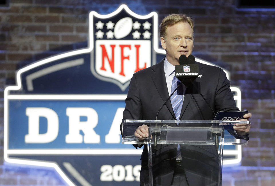 Photo - NFL Commissioner Roger Goodell speaks ahead of the first round at the NFL football draft, Thursday, April 25, 2019, in Nashville, Tenn. (AP Photo/Steve Helber)