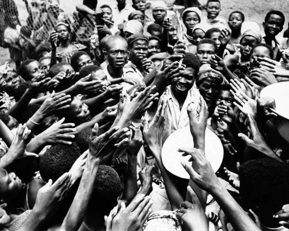Photo -   FILE - In this Jan. 26, 1961 file photo, scores of eager hands reach towards the Congolese official who distributes small rations of dried fish and palm oil to people at the hospital in Miabi, South Kasai, Congo. Faas, a prize-winning combat photographer who carved out new standards for covering war with a camera and became one of the world's legendary photojournalists in nearly half a century with The Associated Press, died Thursday May 10, 2012. He was 79. (AP Photo/Horst Faas, File)