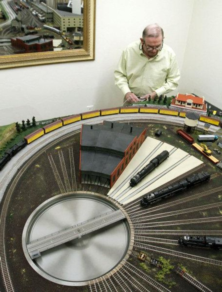 Photo - Jimmy Samis works near a turntable on his train board.