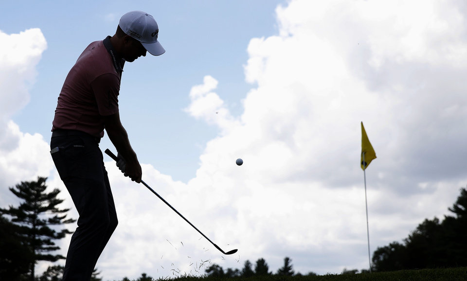 Photo - Chris Kirk chips to the second green during the final round of the Deutsche Bank Championship golf tournament in Norton, Mass., Monday, Sept. 1, 2014. (AP Photo/Michael Dwyer)
