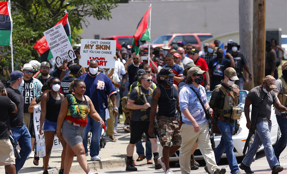 Photo - The marchers head out from Ralph Ellison Library v=crossing NE23rd and MLK Blvd. at a 1,000 brothers and sisters in arms for second amendment walk by predominantly black men and women to advocate for their second amendment rights, Saturday, June 20, 2020. [Doug Hoke/The Oklahoman]
