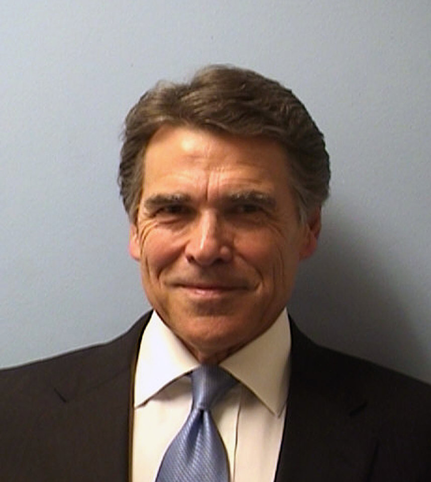 Photo - This image provided by the Austin Police Department shows Texas Gov. Rick Perry while being booked at the Blackwell-Thurman Criminal Justice Center in Austin, Texas, for two felony indictments of abuse of power on Tuesday, Aug. 19, 2014, in Austin, Texas. (AP Photo/Austin Police Department)
