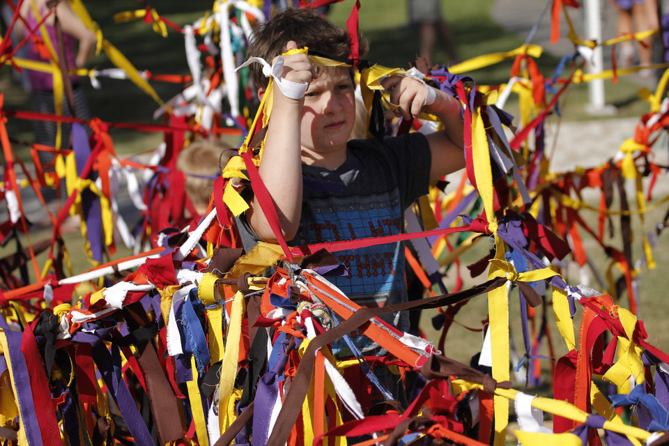 Max Wolfley, 11, gets tangled up at the creation station during the last day of the Festival of the Arts, Sunday, April 28, 2013. Photo by Doug Hoke, The Oklahoman