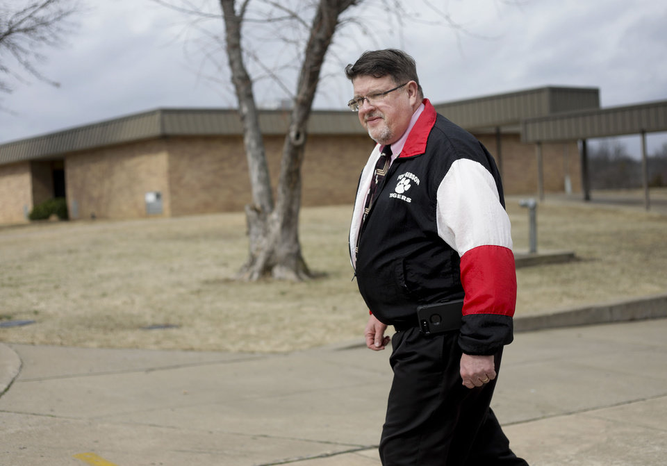 Photo - Greg Phares, principal of Fort Gibson Middle School, in the courtyard where the shooting happened Feb. 19, 2018. Phares was principal at the time of the shooting as well.  MIKE SIMONS/Tulsa World
