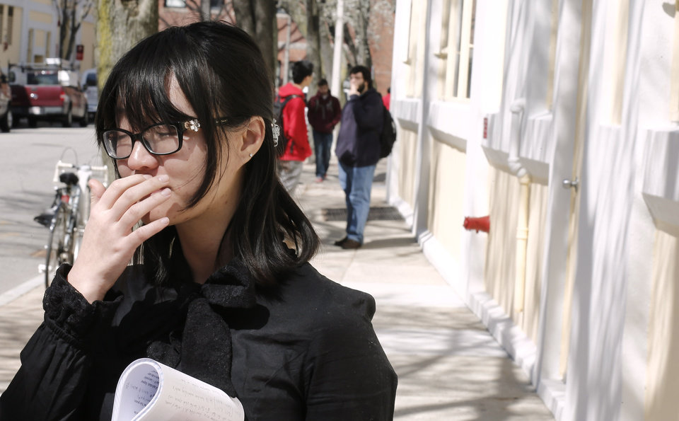 Photo - A Boston University student who knew Boston Marathon bombing victim Lu Lingzi pauses while talking about her friend outside the Boston University School of Mathematics and Statistics in Boston Wednesday, April 17, 2013. (AP Photo/Winslow Townson)