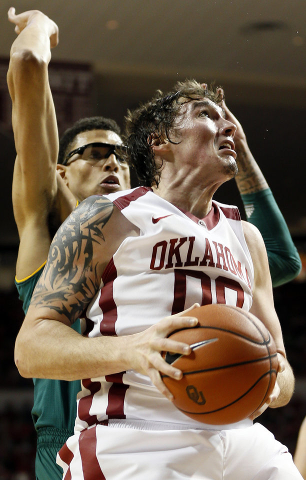 Photo - Oklahoma's Ryan Spangler (00) looks to score in front of Baylor's Isaiah Austin (21) during an NCAA men's college basketball game between Baylor and the University of Oklahoma (OU) at Lloyd Noble Center in Norman, Okla., Saturday, Feb. 8, 2014. Photo by Nate Billings, The Oklahoman