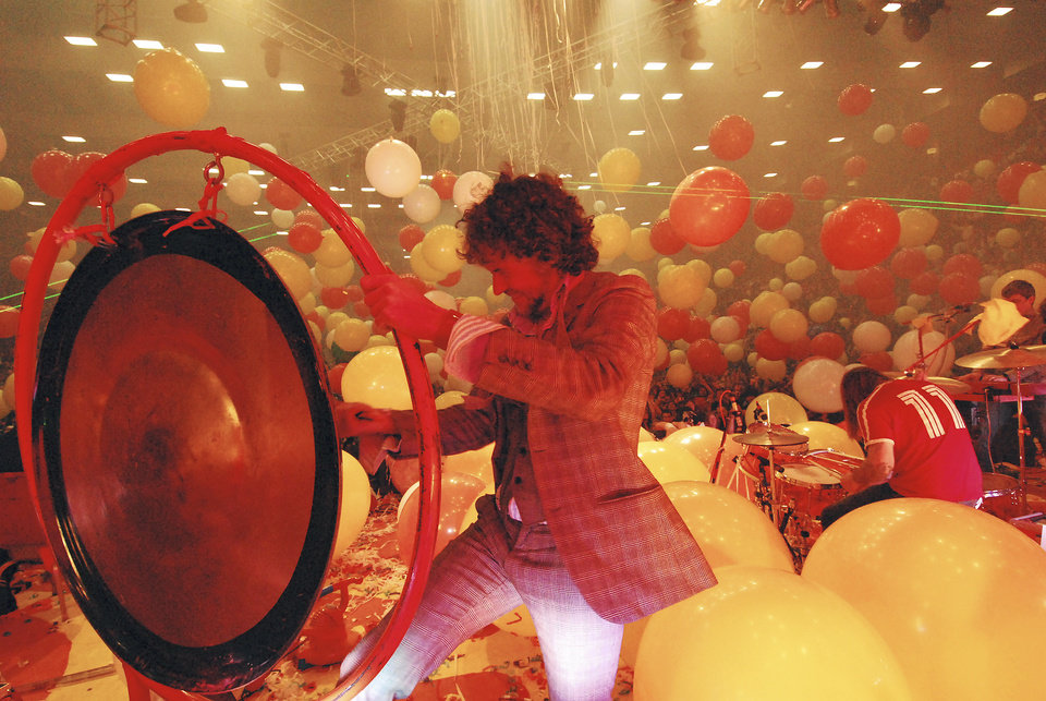 Photo - Wayne Coyne of The Flaming Lips, above, plans to crowd-surf in a giant space ball, below, on New Year's Eve. Photos by J. Michelle Martin-Coyne