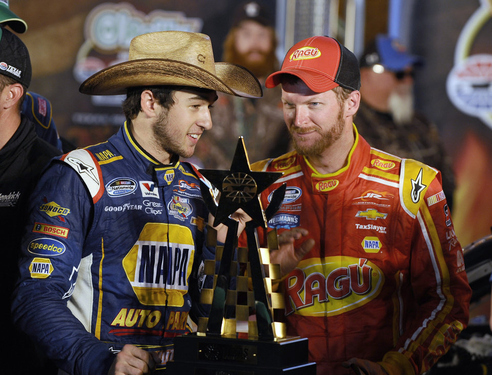 Photo - Chase Elliott, left, talks with team owner Dale Earnhardt Jr. in Victory Lane after Elliot won the NASCAR Nationwide Series auto race at Texas Motor Speedway in Fort Worth, Texas, Friday, April 4, 2014. (AP Photo/Ralph Lauer)