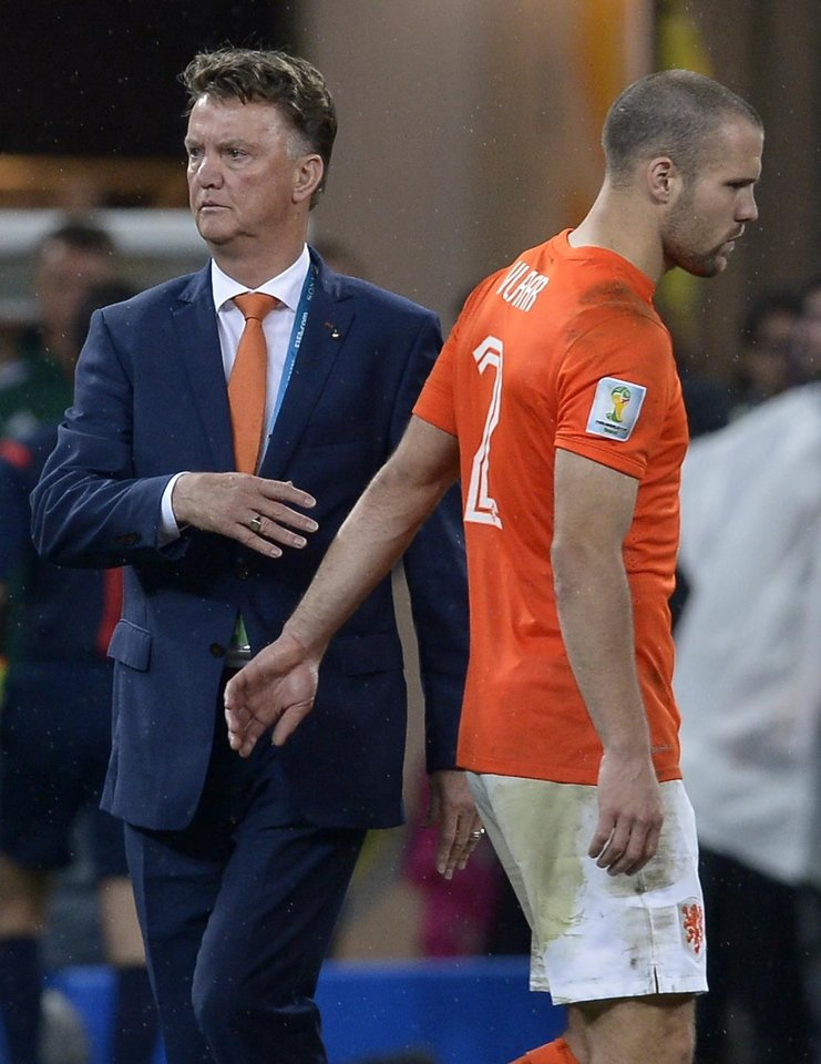 Photo - Netherlands' head coach Louis van Gaal greets Ron Vlaar after losing a shootout at the end of the World Cup semifinal soccer match between the Netherlands and Argentina at the Itaquerao Stadium in Sao Paulo Brazil, Wednesday, July 9, 2014. Argentina won 4-2 on penalties after the match ended 0-0 after extra time.  (AP Photo/Manu Fernandez)