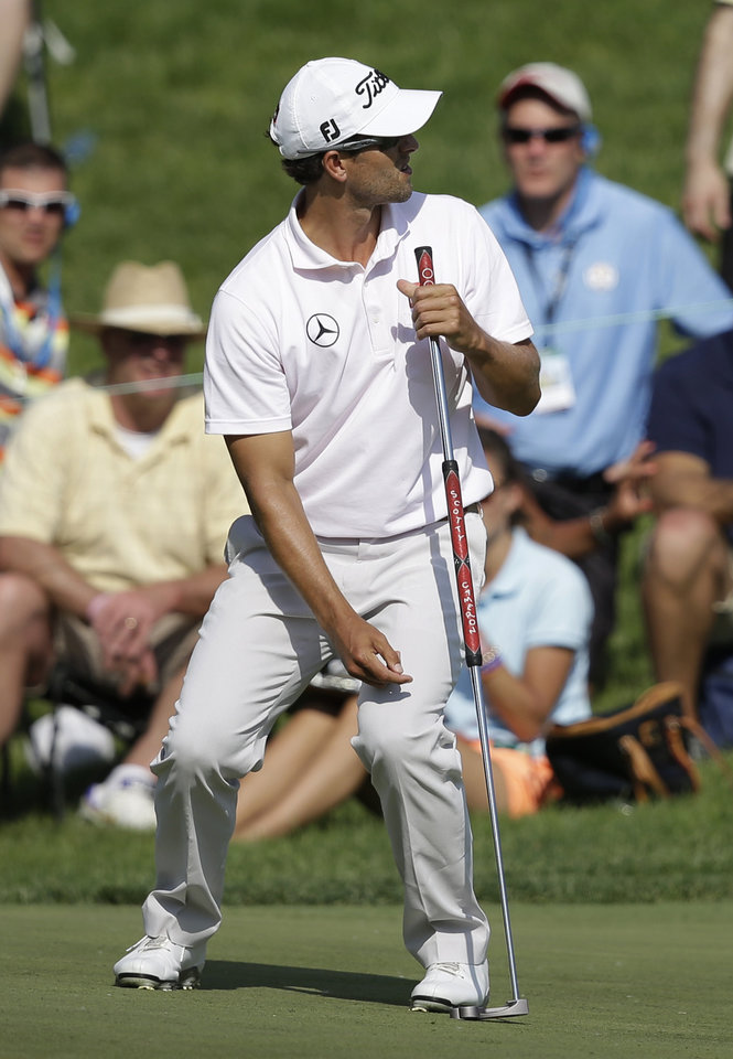 Photo - Adam Scott, of Australia, reacts to a missed putt on the 17th hole during the final round of the Memorial golf tournament Sunday, June 1, 2014, in Dublin, Ohio. (AP Photo/Darron Cummings)