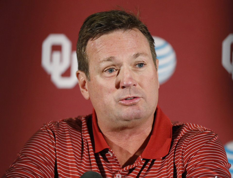 Photo - Oklahoma head coach Bob Stoops answers a question during a news conference in Norman, Okla., Monday, Aug. 25, 2014. Some uncertainties have cleared up as No. 4 Oklahoma prepares to open the season Saturday against Louisiana Tech. (AP Photo/Sue Ogrocki)